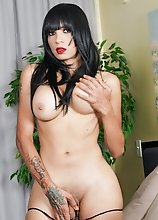 Watch busty tgirl Jennifer Revlon posing, stripping and stroking her cock until she cums!