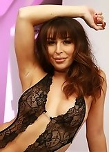 Here's a little photo set of Chanel Santini Posing in some hot black lingerie! This girl just gets better and better by the day! Watch her slip h