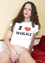 Nicole Montero wearing nothing but an I love Nikki shirt rubs her knob and play with her tight ass