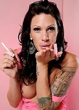 Brunette sweetie Morgan Bailey smoking & stripping