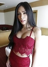 25yo busty Thai shemale strips down to her big tits and cock for her white date
