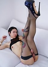 Skinny Asian hottie Hyori stripping, stroking her cock and cumming in this hot solo scene!