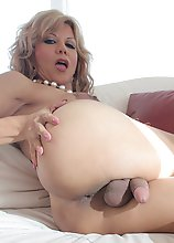 Naomi Chi takes a huge cock up her tranny ass!