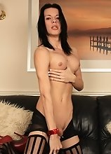 Cute transsexual stripping in sexy black stockings
