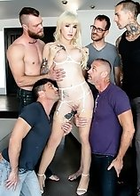 Tattooed T-girl Lena Kelly in skimpy white lingerie gets gangbanged bareback by five studs.